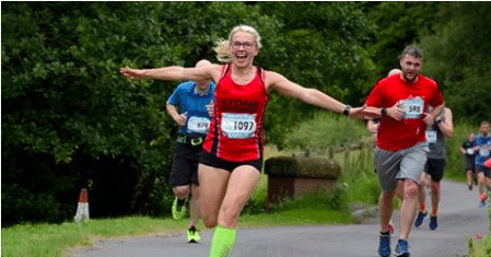 lady running a race