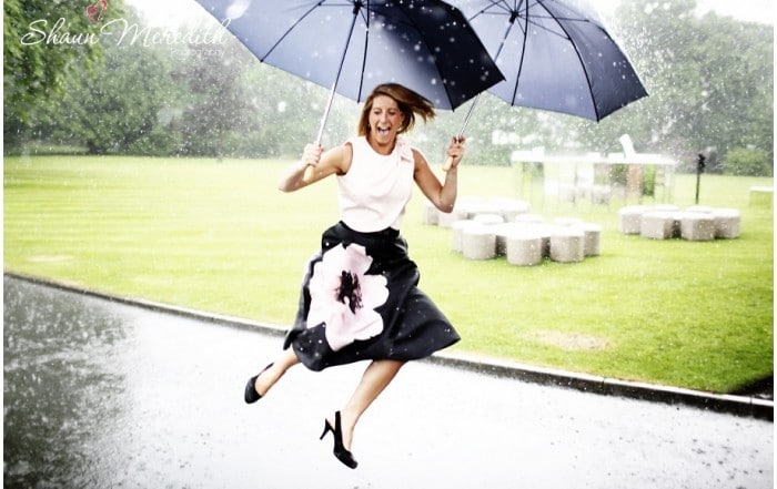 lady jumping In the rain