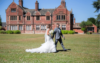 Picture of bride and groom in front of Colshaw Hall